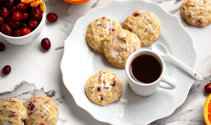 Plate of citrus cranberry cookies with lemon drizzle