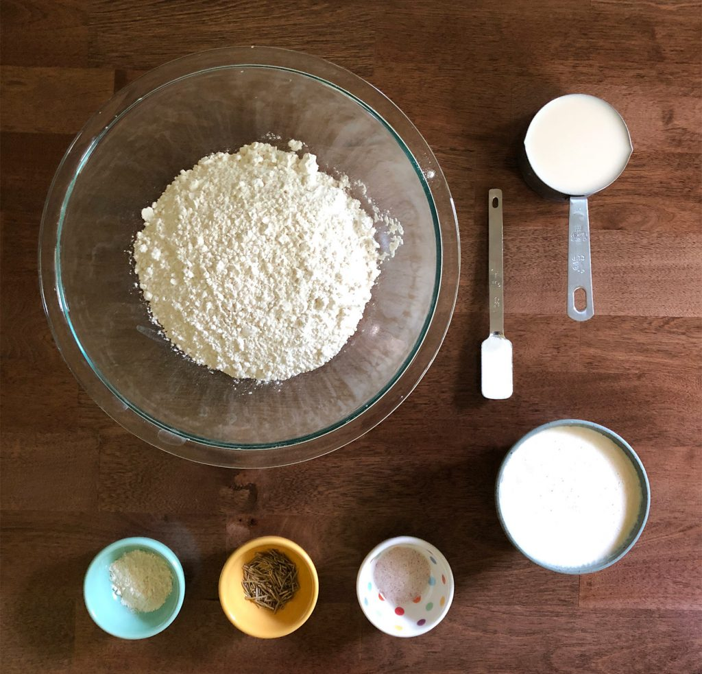 Ingredients laid out: flour, milk, baking powder, and spices