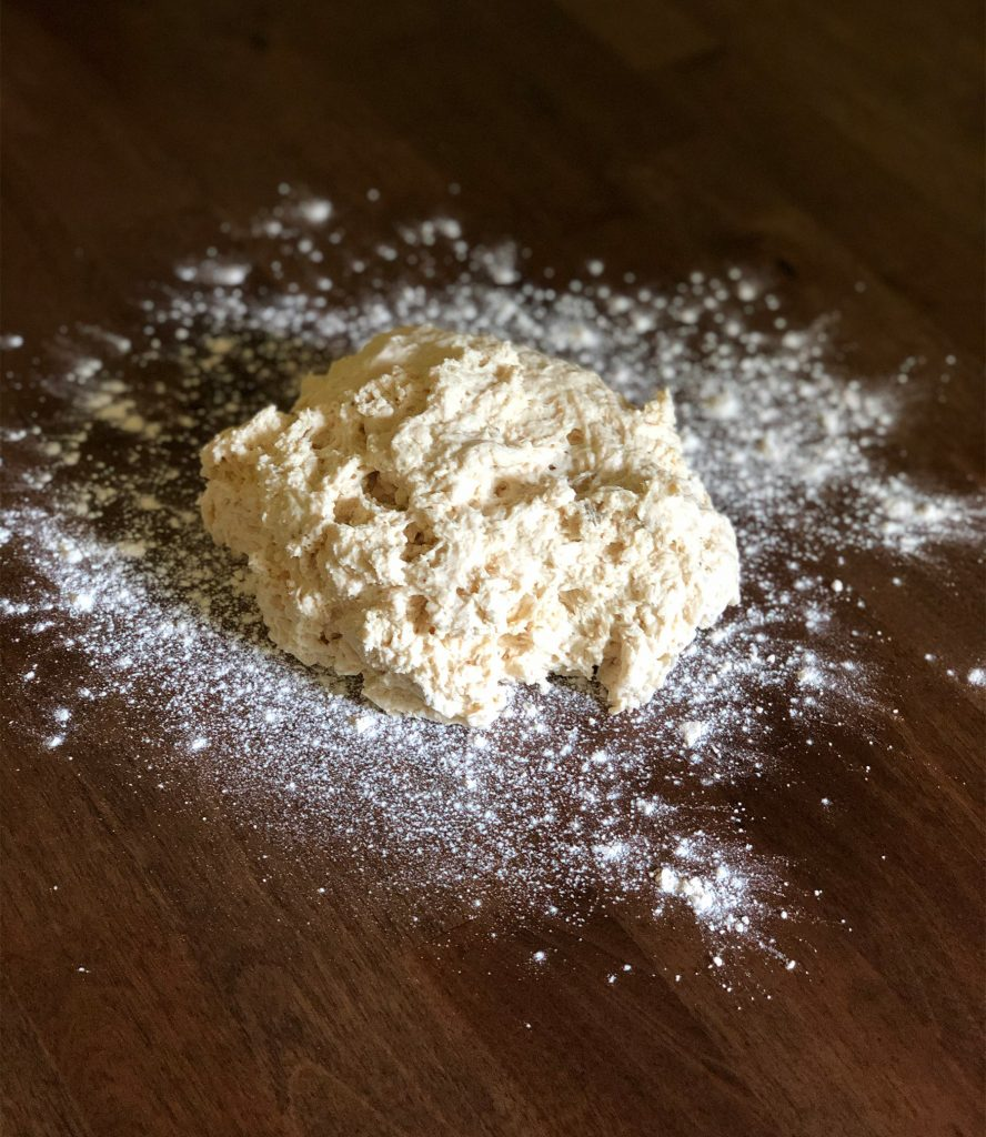 mixed dough on a floured surface